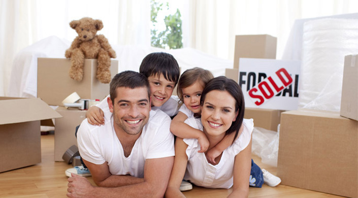 Family with Happy Face Moving Boxes on Heads